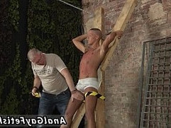 Gay sex 69 Hes bound up to the cross in just his undergarments when