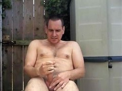 Wanking my oiled cock outdoors in the garden