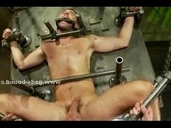 Ropes hold tied gay hunk in bondage sex